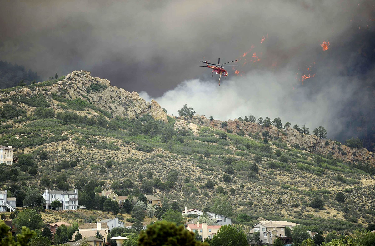 JUNE 26: The Waldo Canyon fire invades the Mountain Shadows neighborhood of Colorado Springs, Colorado Tuesday, June 26, 2012. (Mark Reis/Colorado Springs Gazette/MCT)