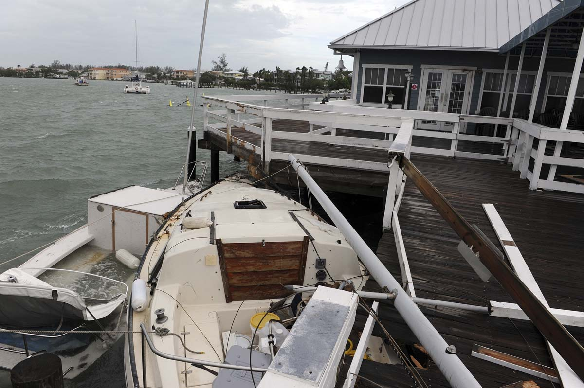 Several boats crashed into the Bridge Street Pier during Tropical Storm Debby, leaving at least one family with no place to live in Manatee County, Florida. (Tiffany Tompkins-Condie/Bradenton Herald)