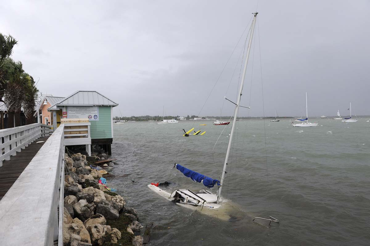 A sailboat drifts in the water near the Bridge Street Pier, damaged by Tropical Storm Debby in Manatee County, Florida. (Tiffany Tompkins-Condie/Bradenton Herald)