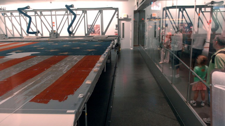 August 31, 2006: Visitors to The National Museum of American History got a glimpse of the cleaned Star Spangled Banner, housed in the glass enclosed room, that flew over Ft. McHenry during the War of 1812. (Doug Kapustin/Baltimore Sun)