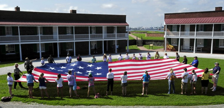 June 14, 2009: With the help of students from Pascagoula HIgh School in Pascagoula, Mississippi, park rangers at Fort McHenry National Monument and Historic Shrine unfurled a replica of the flag flown at the fort during the war of 1812. The 30 ft. by 42 ft. replica is made of nylon; the original was made of wool. In celebration of Flag Day, a flag program presented by The American Flag Foundation, Inc. was held in the evening at Fort McHenry for the 30th Annual National Pause for the Pledge of Allegiance. (Algerina Perna/Baltimore Sun)