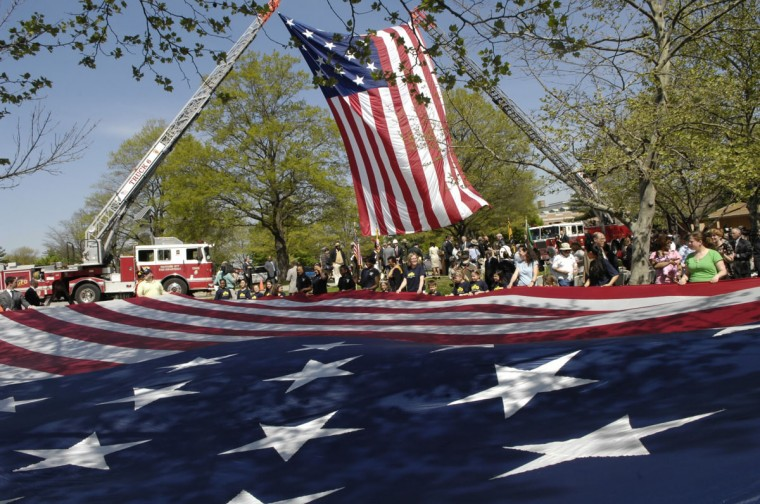 April 27, 2009: Firetrucks support a large American flag at the groundbreaking for new visitor's center at Fort McHenry National Monument and Historic Shrine. Today, more than 600,000 visitors come to Ft. McHenry each year. (Jed Kirschbaum/Baltimore Sun)