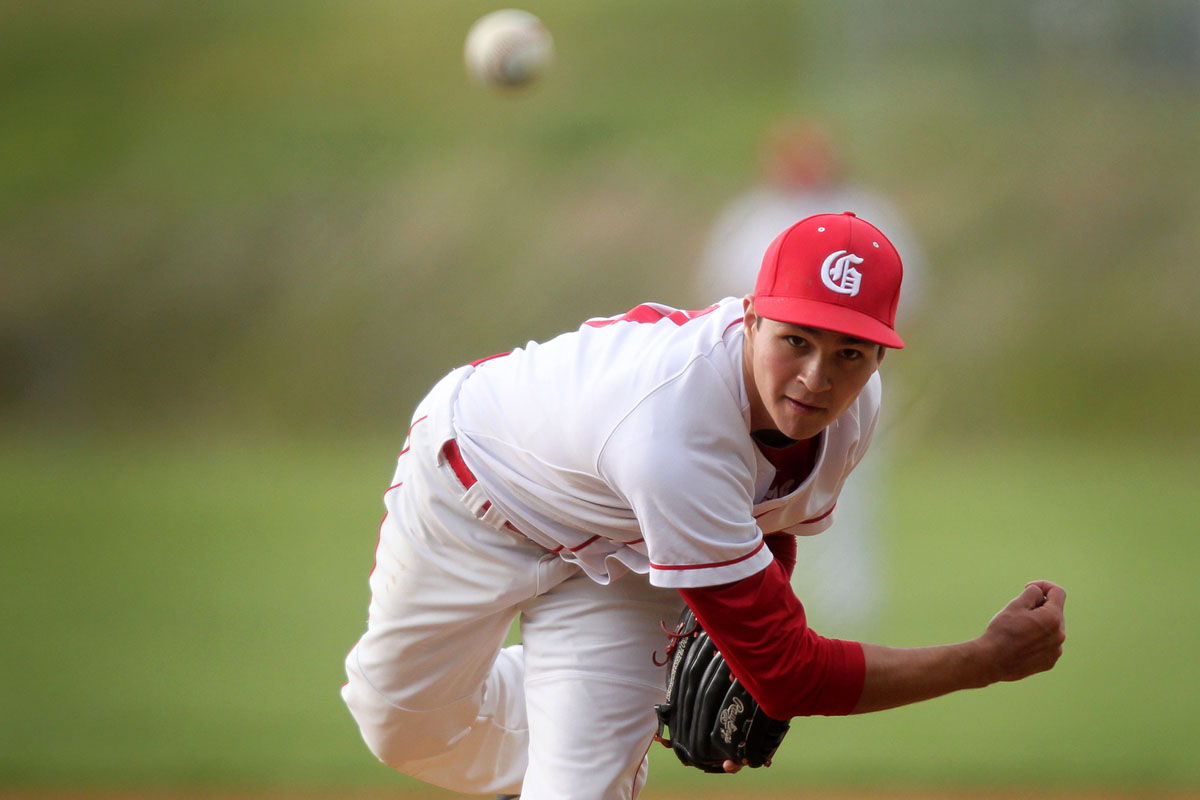 Glenelg's Logan Dubbe pitches during the baseball game against River Hill at Glenelg High School in Glenelg on Tuesday, April 24, 2012. (Jen Rynda/Patuxent Homestead)
