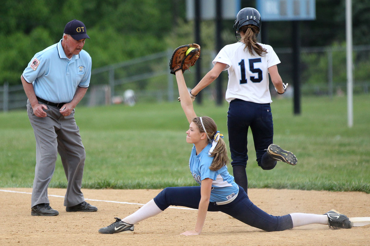 River Hill's Lauren Black stretches to make a catch and get Howard's Taylor Latimer, right, out at first base during the softball game at River Hill High School in Clarksville on Monday, May 7, 2012. (Jen Rynda/Patuxent Homestead)