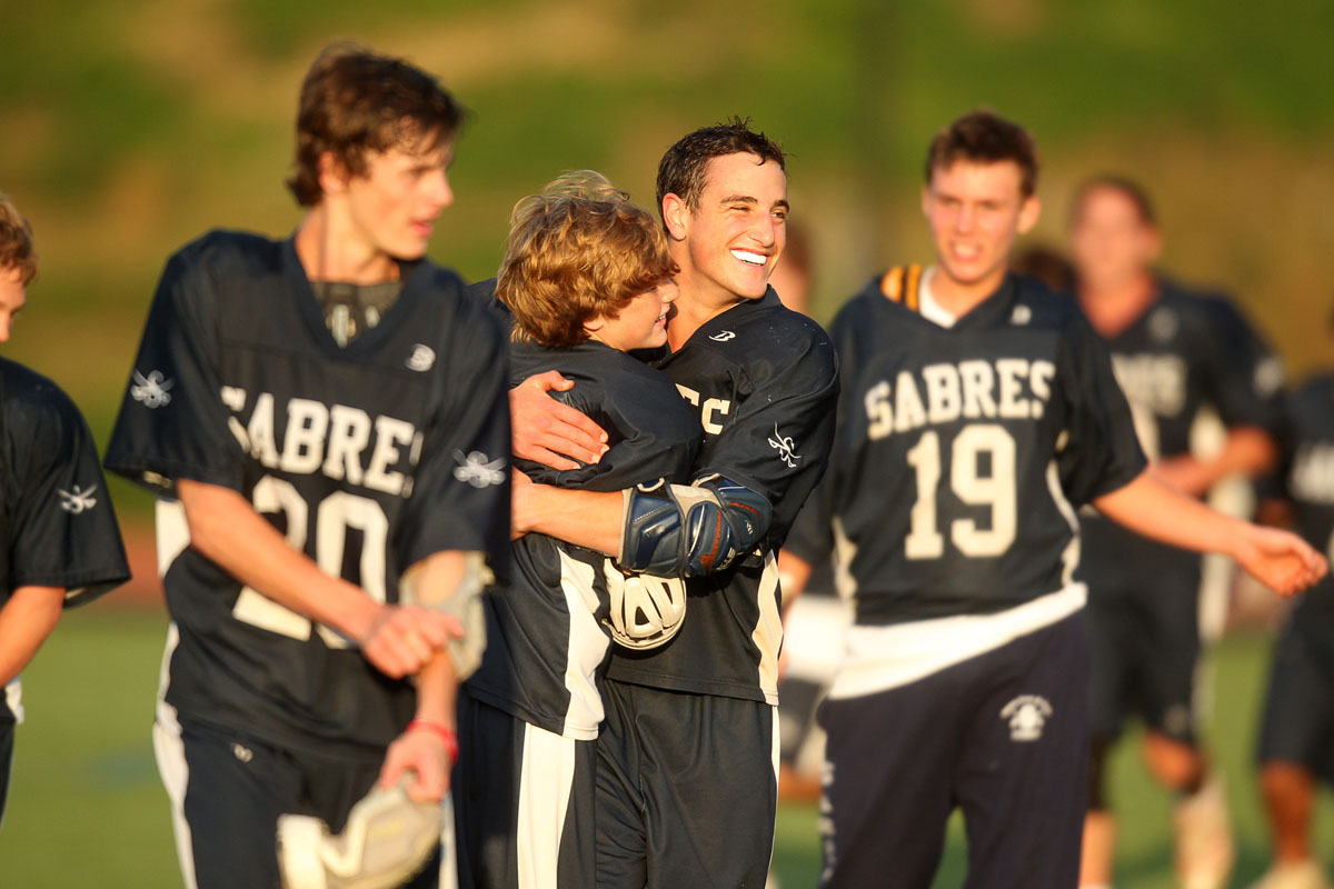 "Saints Peter & Paul's Charlie Cross and Cory Yoviene, center, celebrate their teams win over Friends during the MIAA lacrosse ""B"" conference championship at Towson University Johnny Unitas Stadium in Towson on Friday, May 18, 2012. (Jen Rynda/Patuxent Homestead)"