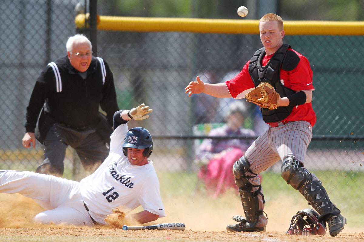 Franklin's Andy Thompson, left, slides into home and scores a run behind Glen Burnie's catcher Ian Dukehart, right, during the baseball game at Glen Burnie High School in Glen Burnie on Thursday, April 5, 2012. (Jen Rynda/Patuxent Homestead)