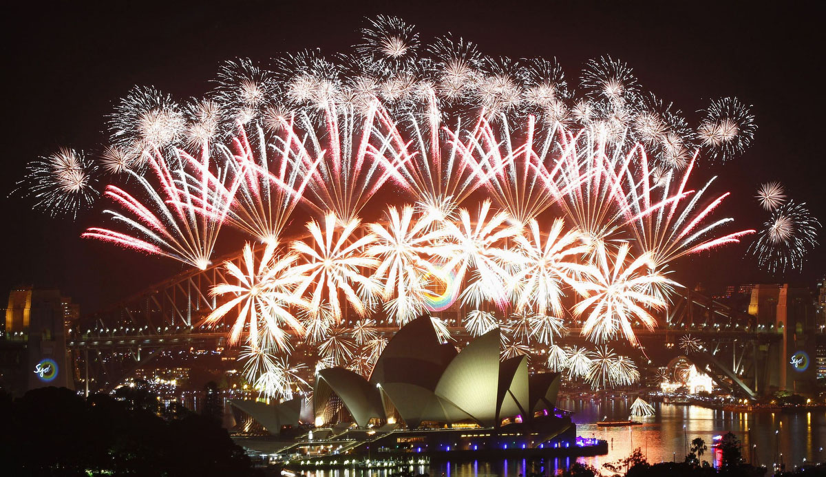 Fireworks explode over the Sydney Harbour Bridge and Opera House during a pyrotechnic show to celebrate the New Year January 1, 2012. (Daniel Munoz / Reuters)