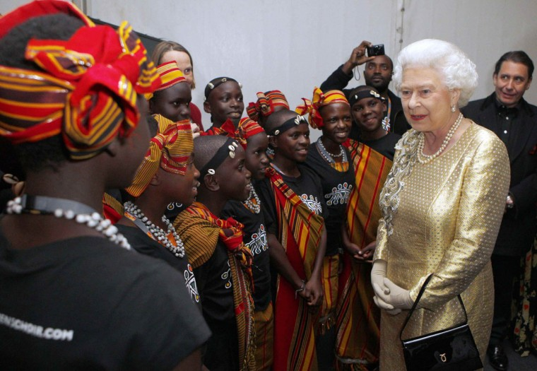 Queen Elizabeth meets dancers from Kenya backstage at the Diamond Jubilee Concert outside Buckingham Palace in London June 4 , 2012. (Dave Thompson/Reuters)
