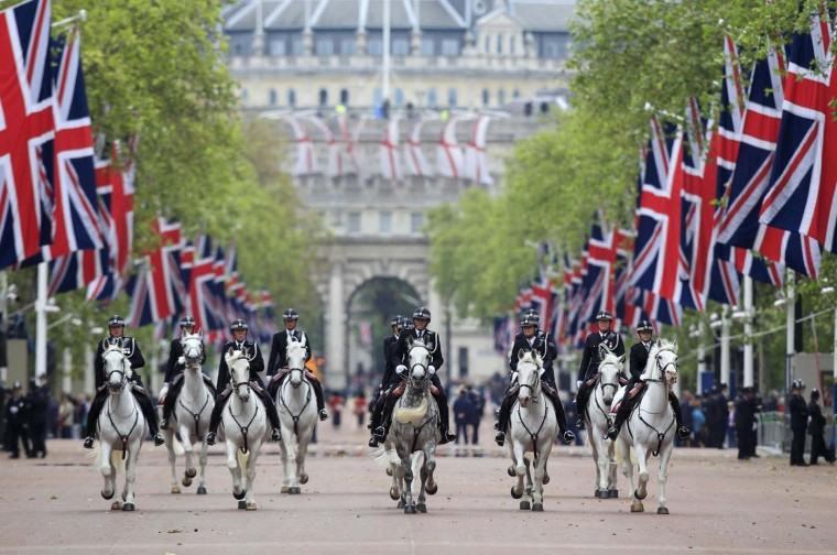 Mounted policemen patrol along The Mall as Britain's Queen Elizabeth attends a Diamond Jubilee service at St. Paul's Cathedral in central London June 5, 2012. (Cathal McNaughton/Reuters)