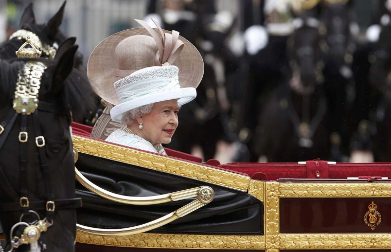 Britain's Queen Elizabeth waves in the 1902 State Landau carriage as she leads a carriage procession through central London, en route to Buckingham Palace June 5, 2012. (Stefan Wermuth/Reuters)