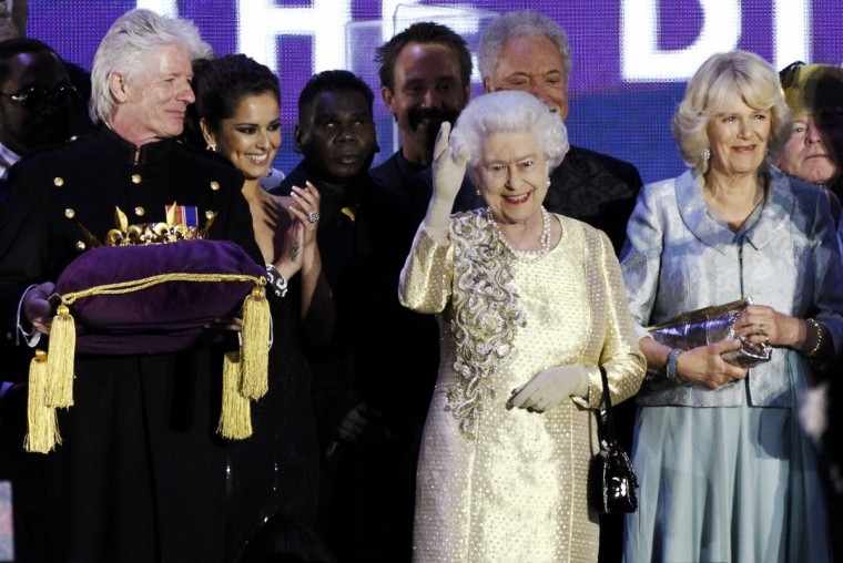 Britain's Queen Elizabeth waves to the crowd as the Jubilee crystal (L) is brought onto the stage during her Diamond Jubilee concert in front of Buckingham Palace in London June 4, 2012. Also in the picture is Camilla (R), Duchess of Cornwall. (David Moir/Reuters)