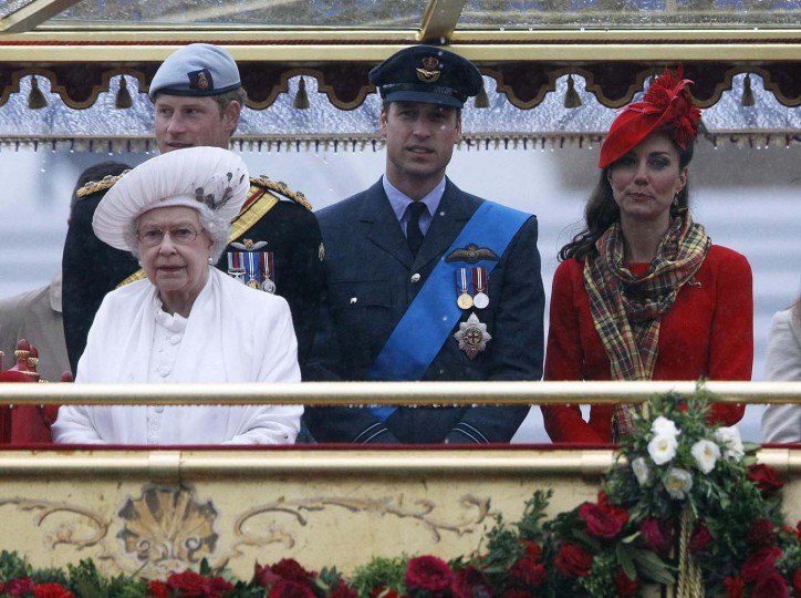 Britain's Queen Elizabeth watches from onboard the Spirit of Chartwell with (L-R) Prince Harry, Prince William, and Catherine, Duchess of Cambridge during her Diamond Jubilee Pageant on the River Thames in London June 3, 2012. (Darren Staples/Reuters)