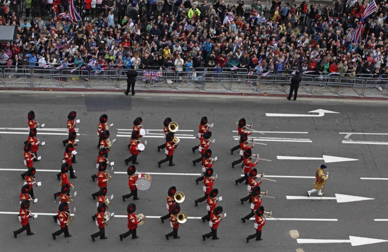 A military marching band plays music as crowds line up to watch the carriage procession carrying the Royal family, during Queen Elizabeth's Diamond Jubilee in London June 5, 2012. (Elizabeth Dalziel/Reuters)
