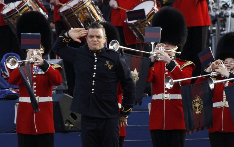 Singer Robbie Williams performs during the Diamond Jubilee concert in front of Buckingham Palace in London June 4, 2012. Robbie Williams kicked off the concert outside Queen Elizabeth's sumptuous London residence on Monday as huge crowds gathered to celebrate the monarch's 60 years on the throne. (David Moir/Reuters)