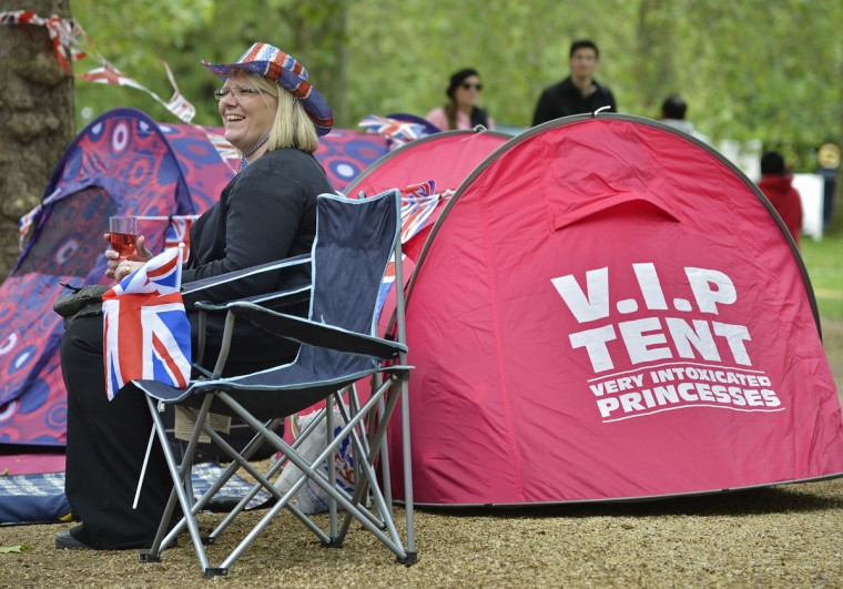 A spectator relaxes on a portable chair on The Mall ahead of a concert at Buckingham Palace in London June 4, 2012. (Toby Melville/Reuters)