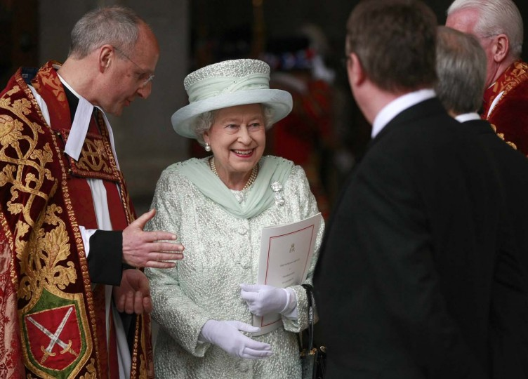 Britain's Queen Elizabeth, next to the Dean of St. Paul's David Ison (L) leaves after a service of thanksgiving to celebrate her Diamond Jubilee at St Paul's Cathedral in central London June 5, 2012. (Tim Hales/Getty Images)