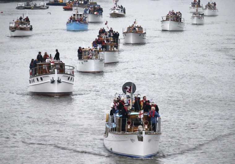 Boats of all shapes and sizes muster on the River Thames, in celebration of the Queen's Diamond Jubilee, near Putney Bridge in London June 3, 2012. (Kevin Coombs/Reuters)