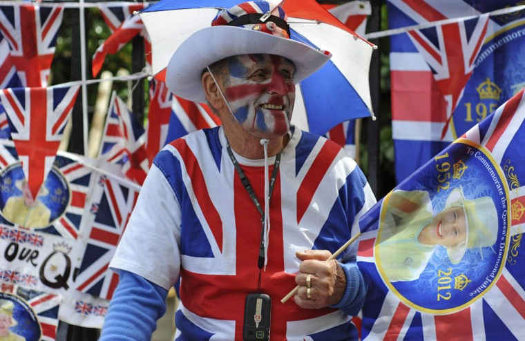 A man wears a Union Flag outfit as he waits on The Mall for the start of the Diamond Jubilee concert for Britain's Queen Elizabeth in London June 4, 2012. (Ki Price/Reuters)