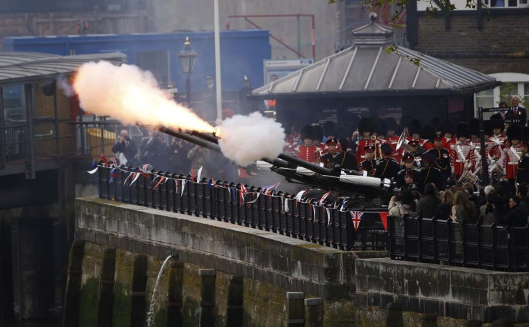 Army guards fire canons during the Queen's Diamond Jubilee Pageant on the River Thames in London June 3, 2012. (Suzanne Plunkett/Reuters)