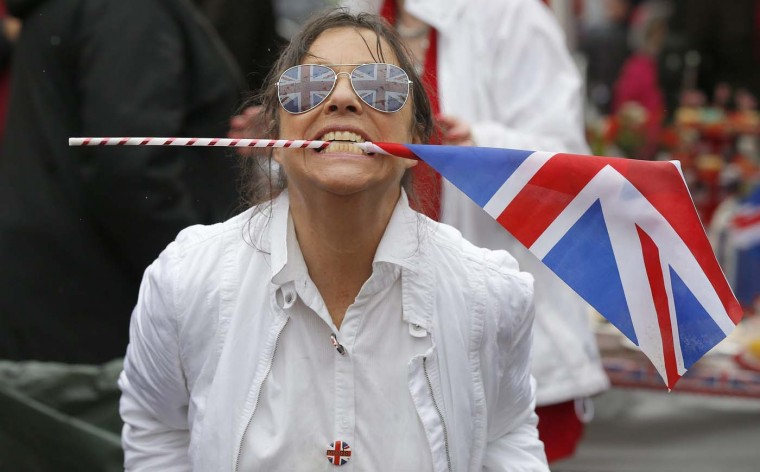 A woman dances with a Union Jack Flag in her mouth during a street party to celebrate Queen Elizabeth's Diamond Jubilee in Marple Bridge, northern England June 3, 2012. (Phil Noble/Reuters)