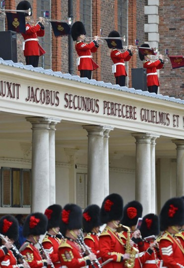The Band of the Coldstream Guards and the Trumpeters of the Grenadier Guards play at the annual Founder's Day parade at the Royal Hospital in Chelsea. (Miguel Medina/Getty Images)