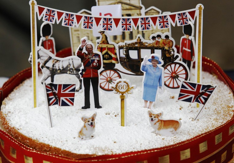 "A sponge is decorated with cut-outs of Britain's Queen Elizabeth II and Prince Philip at the Goldsmith Avenue Street Party to mark the Diamond Jubilee of Queen Elizabeth, in Ealing, west London June 4, 2012. ""Elizabeth rules the waves!"" was just one headline from gushing British press coverage of Queen Elizabeth's Diamond Jubilee on Monday, the third day of celebrations that have bolstered a royal family once mired in scandal and dismissed as outdated. (Luke MacGregor/Reuters)"