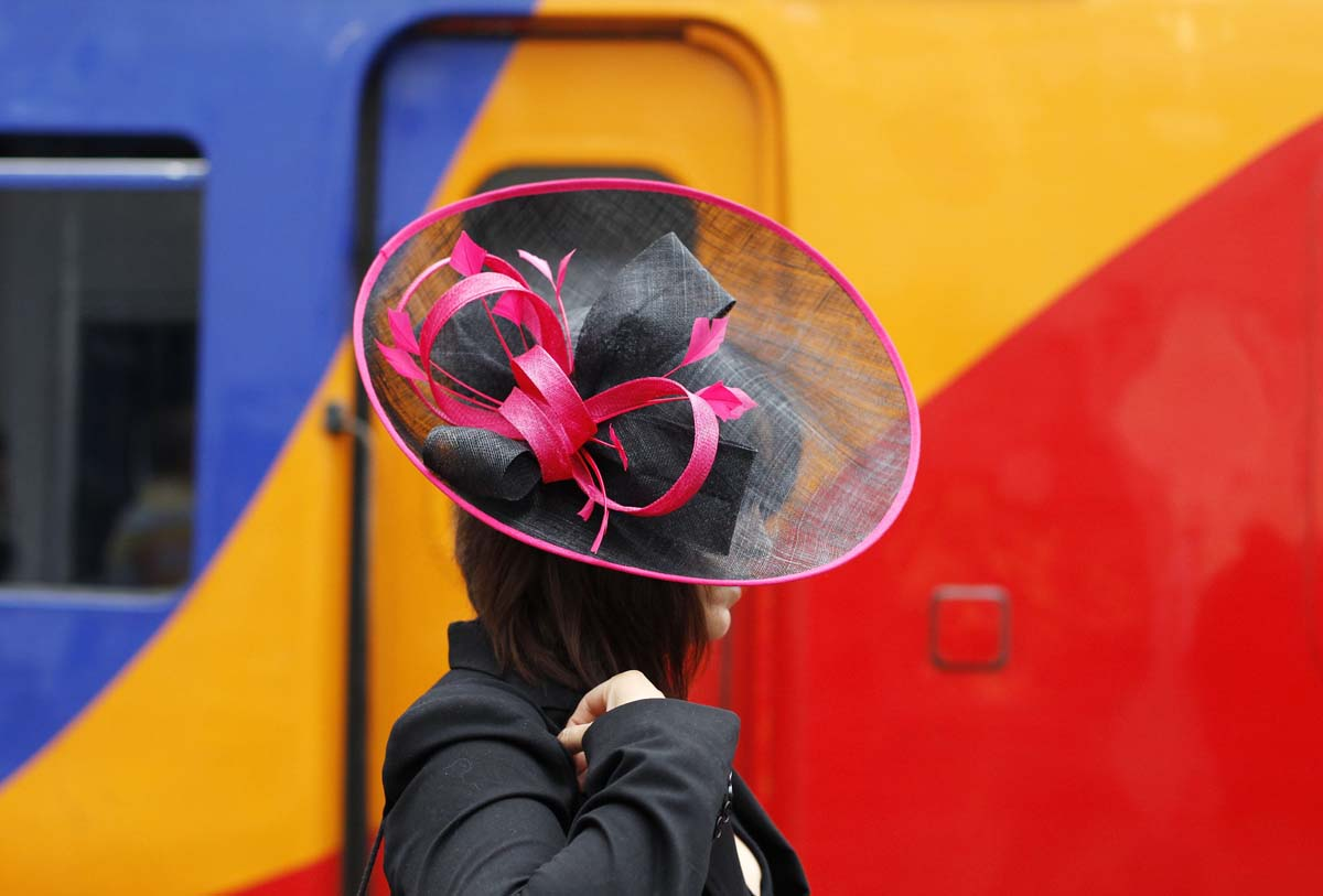 A race goer prepares to board a train to Royal Ascot on Ladies' Day, southwest of London. (Andrew Winning/Reuters photo)