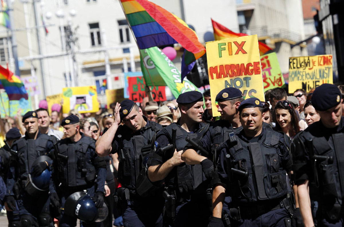 Zagreb: Riot police secure a gay pride parade June 16, 2012. About a thousand participants attended the Zagreb Gay Pride parade in the capital and largest city in Croatia. (Antonio Bronic/Reuters)