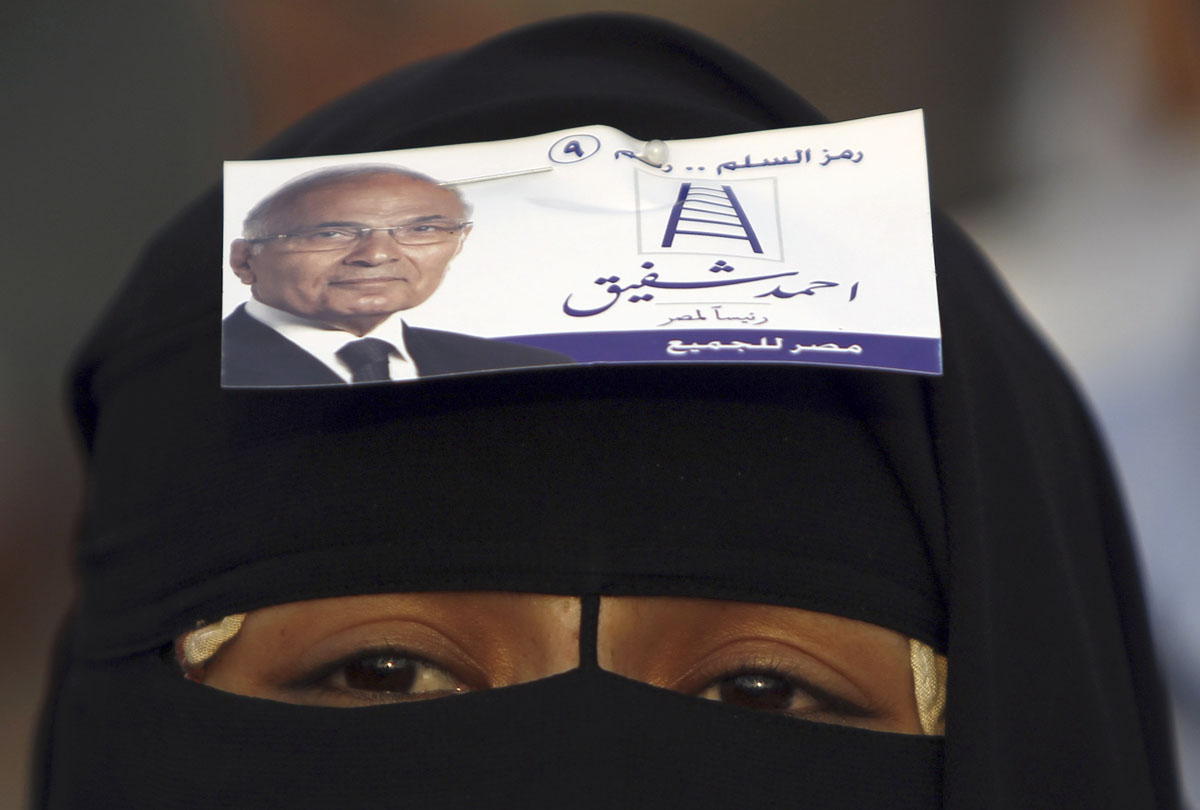 June 23, 2012: A veiled supporter of former prime minister and current presidential candidate Ahmed Shafik shouts slogans against the Muslim Brotherhood's presidential candidate Mohamed Morsy during a rally in support of the Supreme Council for the Armed Forces (SCAF) in front of the military parade stand at Nasr City in Cairo. (Amr Abdallah Dalsh/Reuters)