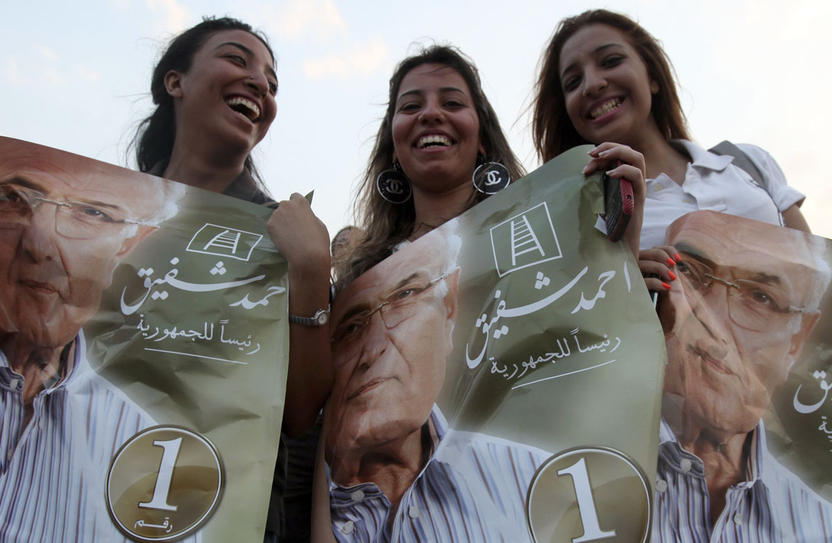 June 23, 2012: Women supporters of former prime minister and current presidential candidate Ahmed Shafik shout slogans against the Muslim Brotherhood's presidential candidate Mohamed Morsy during a rally in support of the Supreme Council for the Armed Forces (SCAF) at Nasr City in Cairo. (Amr Abdallah Dalsh/Reuters)