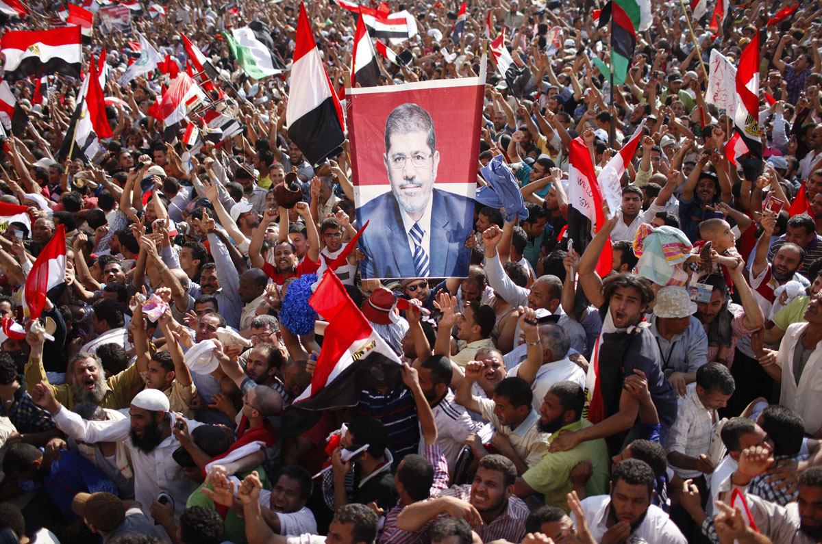 June 24, 2012: Supporters of Muslim Brotherhood's presidential candidate Mohamed Morsy celebrate his victory at the election at Tahrir Square in Cairo. (Ahmed Jadallah/Reuters)