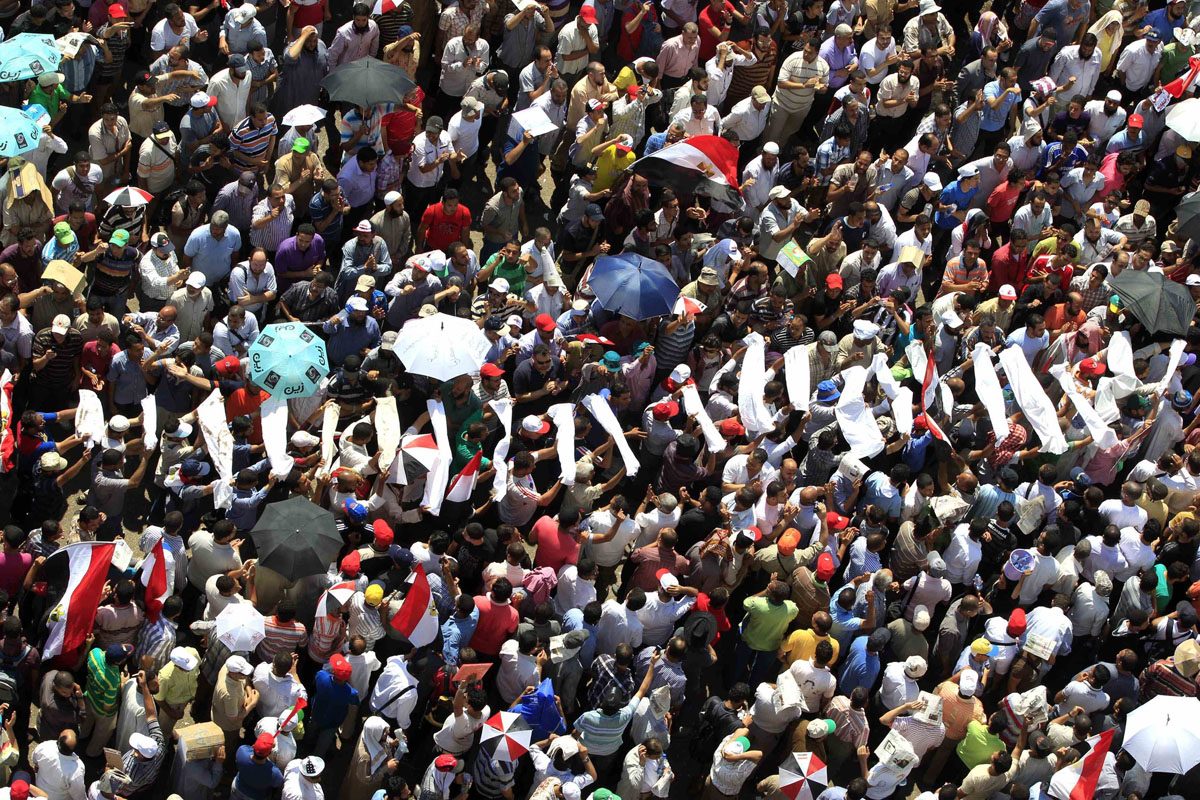 June 24, 2012: Supporters of Muslim Brotherhood's presidential candidate Mohamed Morsy carry mock coffins during a rally at Tahrir Square in Cairo. Egypt's ruling armed forces were on alert on Sunday as fears of violence mounted in the final hours before the state election committee is to name the winner of last weekend's presidential election at 3 p.m. (Ahmed Jadallah/Reuters)
