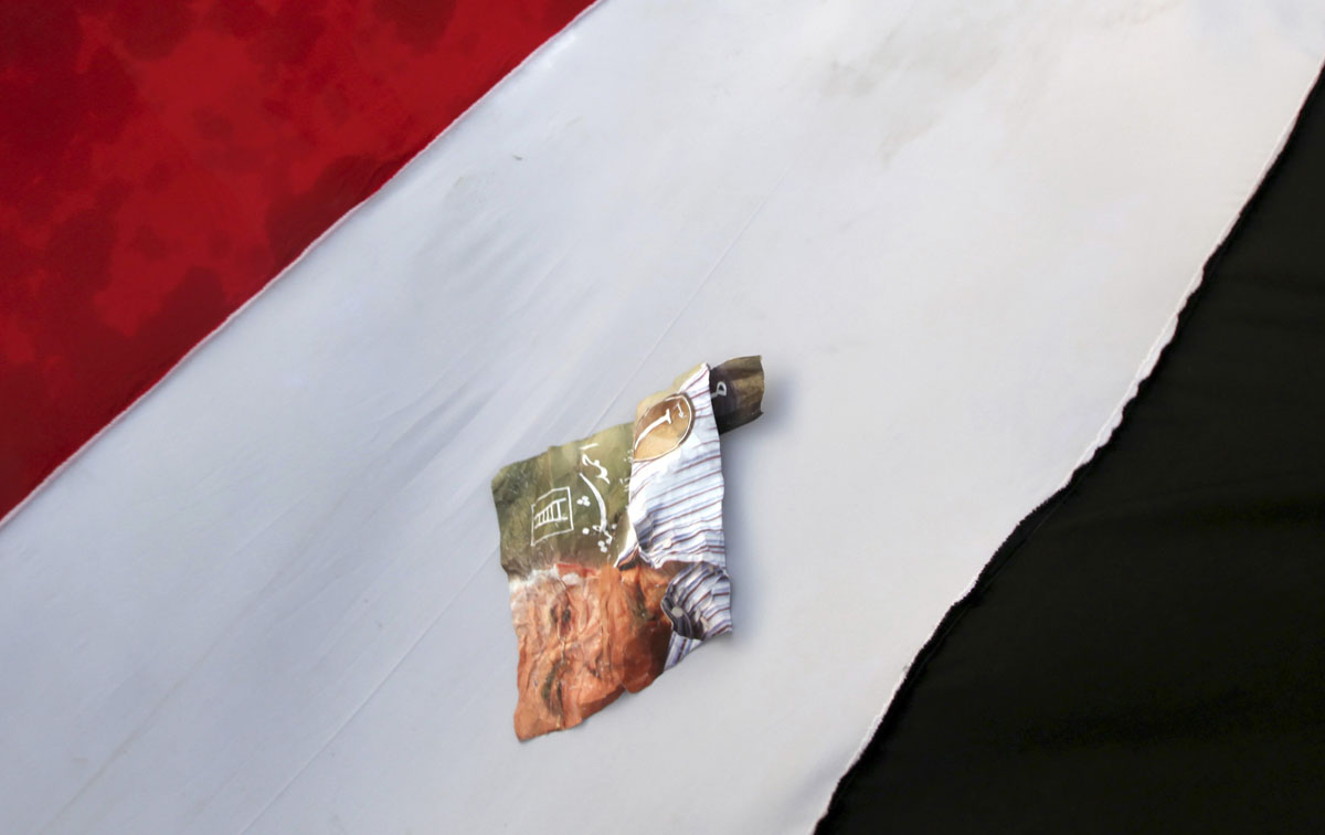 June 23, 2012: A poster of former prime minister and current presidential candidate Ahmed Shafik is seen on an Egyptian flag, in protest against the Muslim Brotherhood's presidential candidate Mohamed Morsy, during a rally in support of the Supreme Council for the Armed Forces (SCAF) held in front of the military parade stand at Nasr City in Cairo. (Amr Abdallah Dalsh/Reuters)