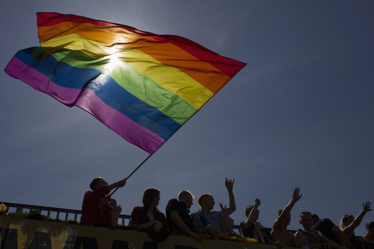 Berlin: A reveler waves the rainbow flag during the Christopher Street Day parade June 23, 2012. The annual street parade parade is a celebration of lesbian, gay, bisexual, and transgender lifestyles and denounces discrimination and exclusion. (Thomas Peter/Reuters)
