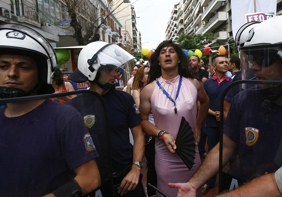 Thessaloniki: A participant stands amidst police officers during a gay parade in northern Greece June 23, 2012. Several protesters against the parade, which took place for the first time in the city, gathered in an attempt to block the event from happening. (Grigoris Siamidis/Reuters)