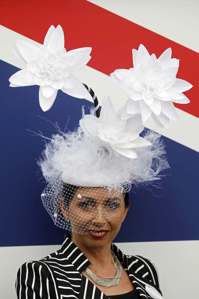 Racegoer Claire Winnall poses for photographs on Ladies' Day, the third day of racing at the Royal Ascot, southwest of London. (Stefan Wermuth/Reuters photo)