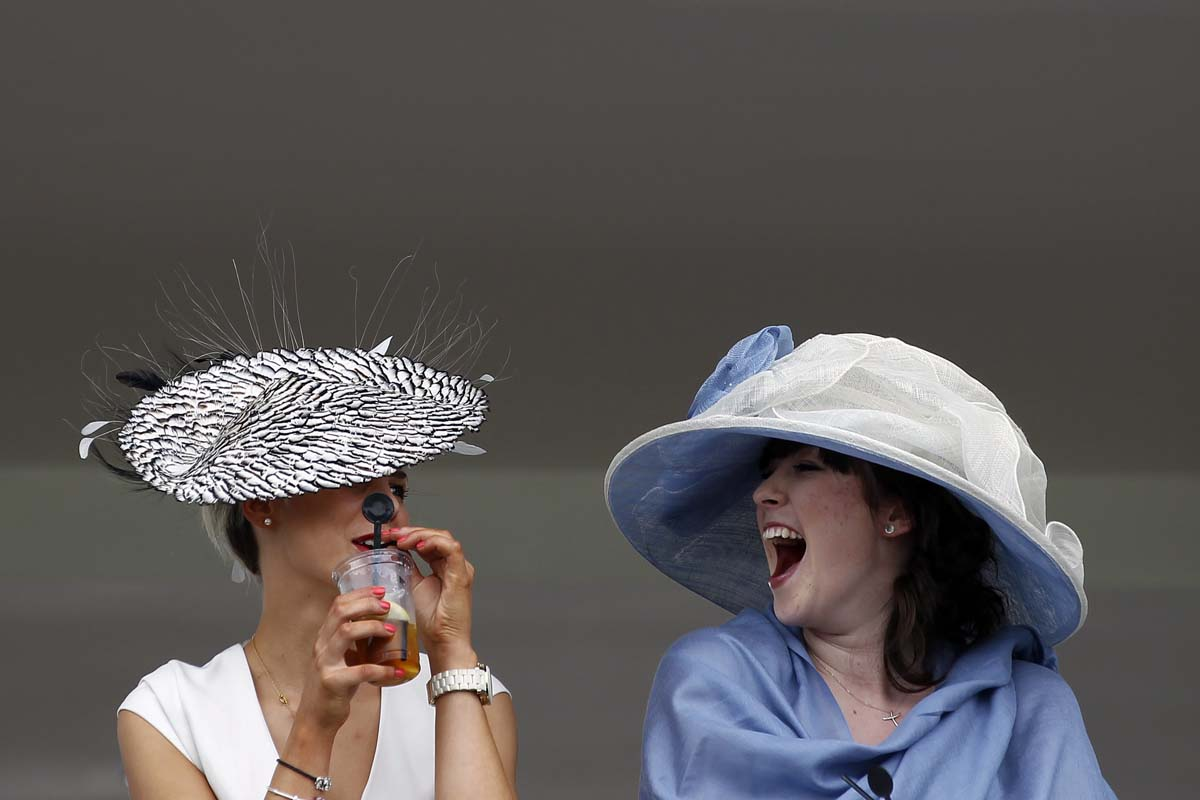 Racegoers attend Ladies Day, the third day of racing at the Royal Ascot, southwest of London. (Stefan Wermuth/Reuters Photo)