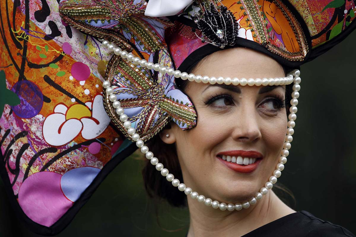 Racegoer Carla Creegan poses for photographs on Ladies' Day, the third day of racing at the Royal Ascot, southwest of London. (Stefan Wermuth/Reuters Photo)