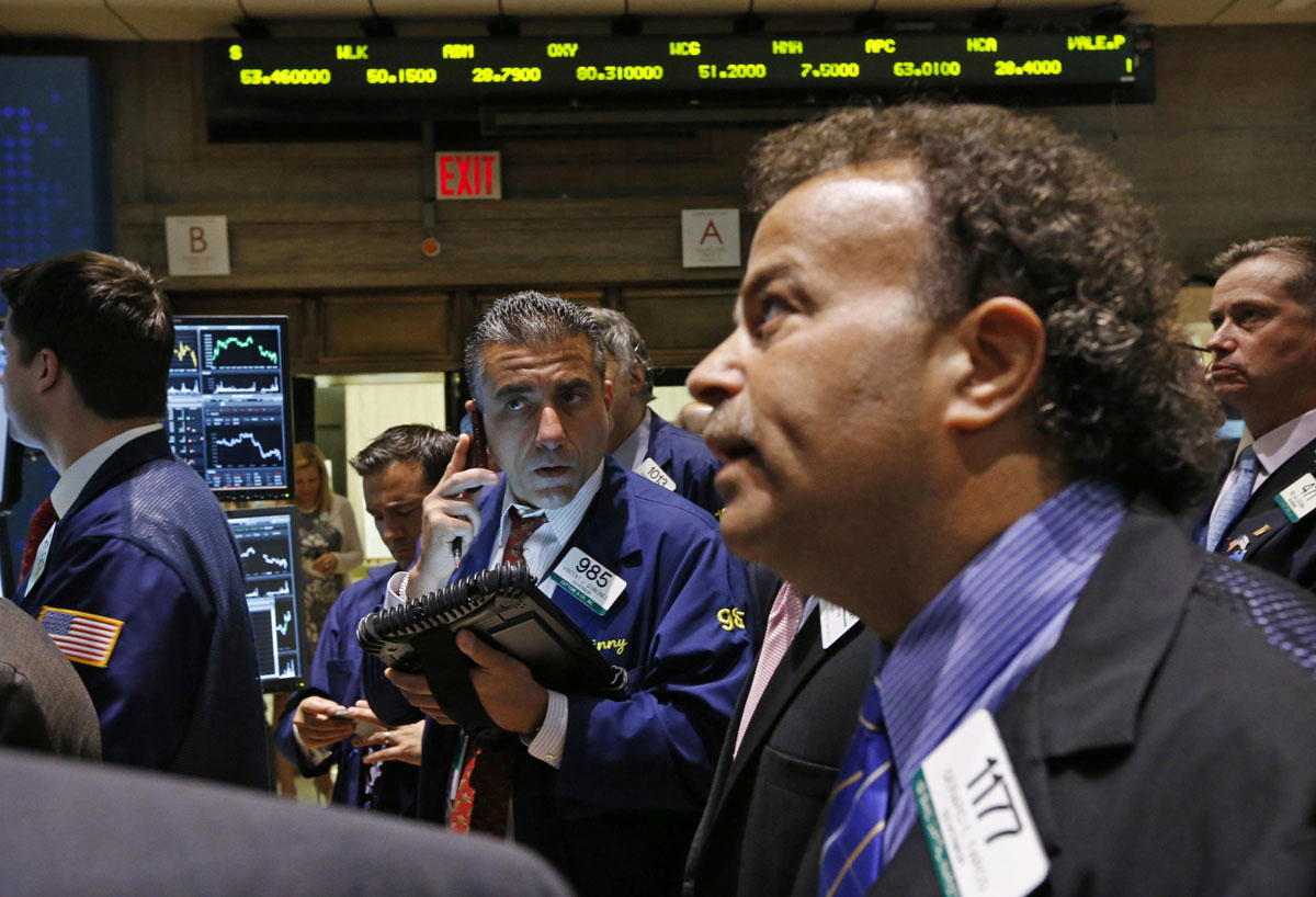 June 28, 2012: Traders work on the floor of the New York Stock Exchange following the Supreme Court's decision on healthcare, June 28, 2012. Wall Street fell more than 1 percent on Thursday, with healthcare stocks trading erratically after the U.S. Supreme Court upheld a key part of President Barack Obama's healthcare overhaul in a surprise move for many investors. (Brendan McDermid/Reuters)