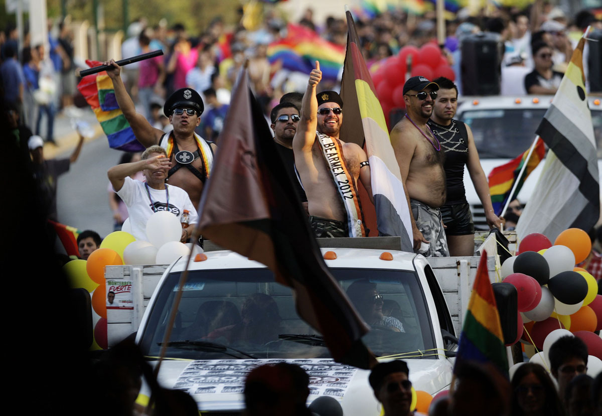 Monterrey: Participants on a vehicle take part in a parade celebrating sexual diversity June 23, 2012. Thousands of members and supporters of the Lesbian, Gay, Bisexual and Transgender (LGBT) community took part in the event on Saturday. (Daniel Becerril/Reuters)
