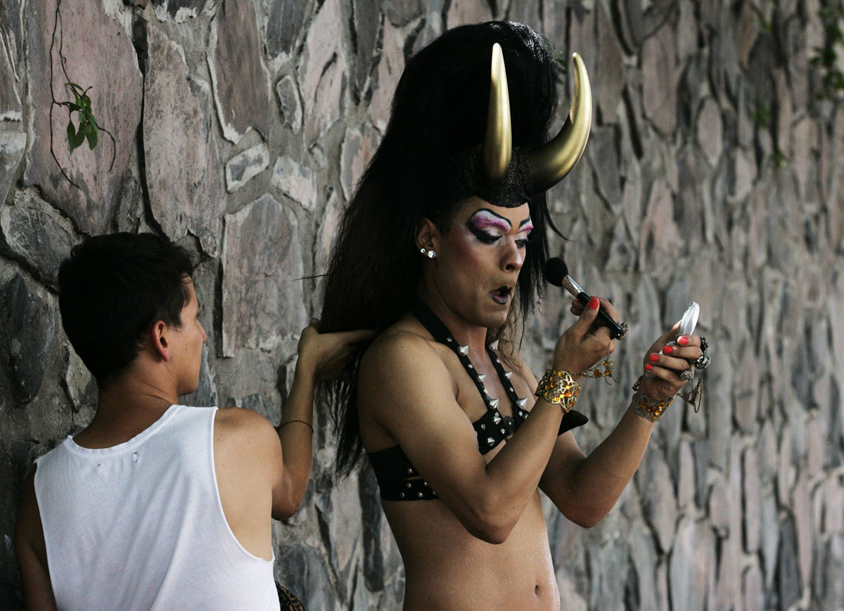 Guadalajara: A participant paints his face before taking part in a parade celebrating sexual diversity June 23, 2012. Thousands of members and supporters of the Lesbian, Gay, Bisexual and Transgender (LGBT) community took part in the event on Saturday. (Alejandro Acosta/Reuters)