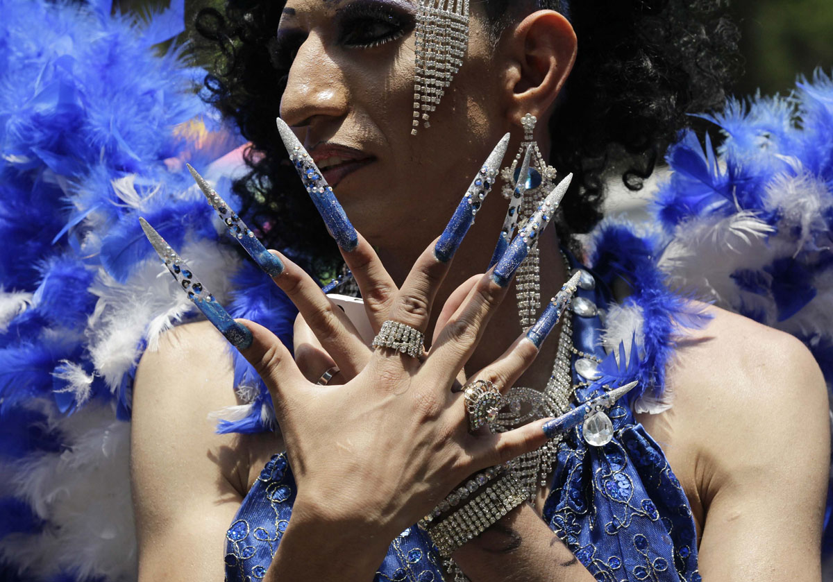 Mexico City: A participant gestures during the Gay Pride Parade June 2, 2012. Thousands of gays, lesbians, transsexuals and supporters took part in the parade. (Henry Romero/Reuters)