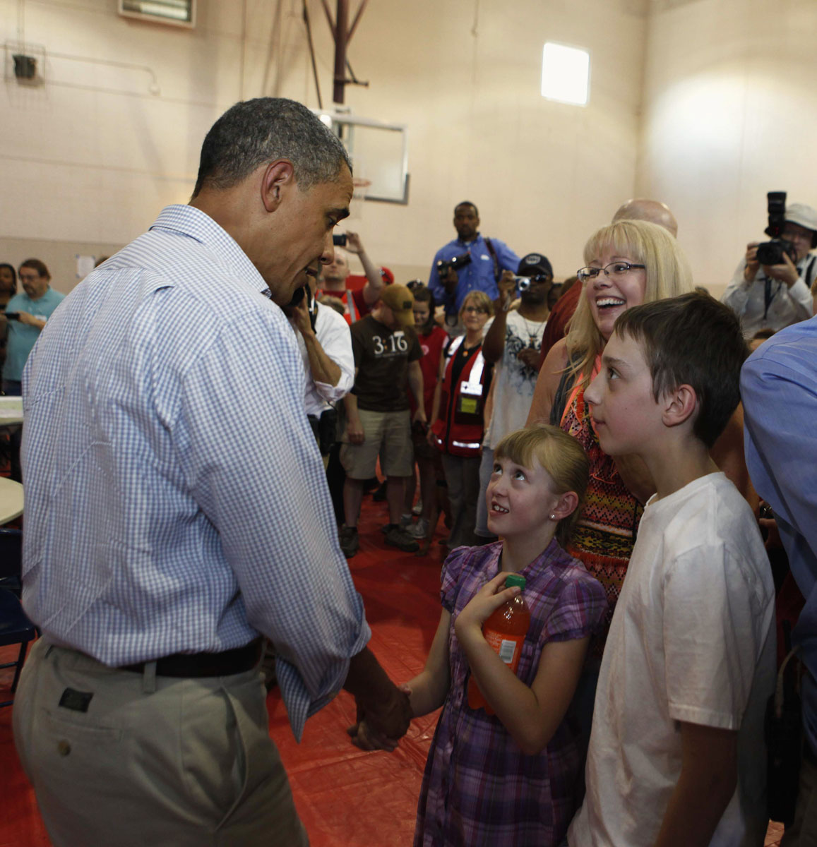 JUNE 29: U.S. President Barack Obama (R) greets children at an evacuation center at a YMCA in Colorado Springs, June 29, 2012. Obama declared local areas earlier today as a federal disaster area releasing federal funds to help fight the blazes. (Larry Downing/Reuters)