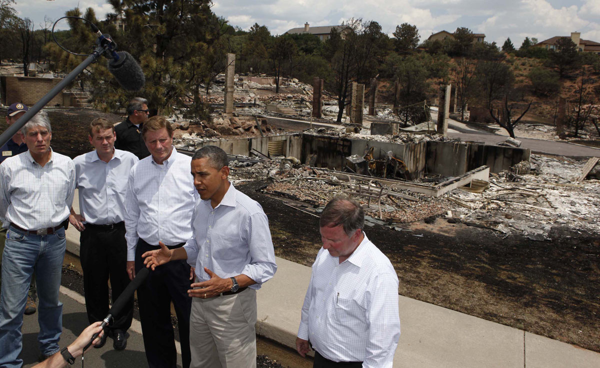 JUNE 29: U.S. President Barack Obama speaks to the media during his visit to fire damaged homes in the Mountain Shadow neighborhood in Colorado Springs, June 29, 2012. Obama declared those areas on Friday as a federal disaster area releasing federal funds to help fight the blazes. (Larry Downing/Reuters)