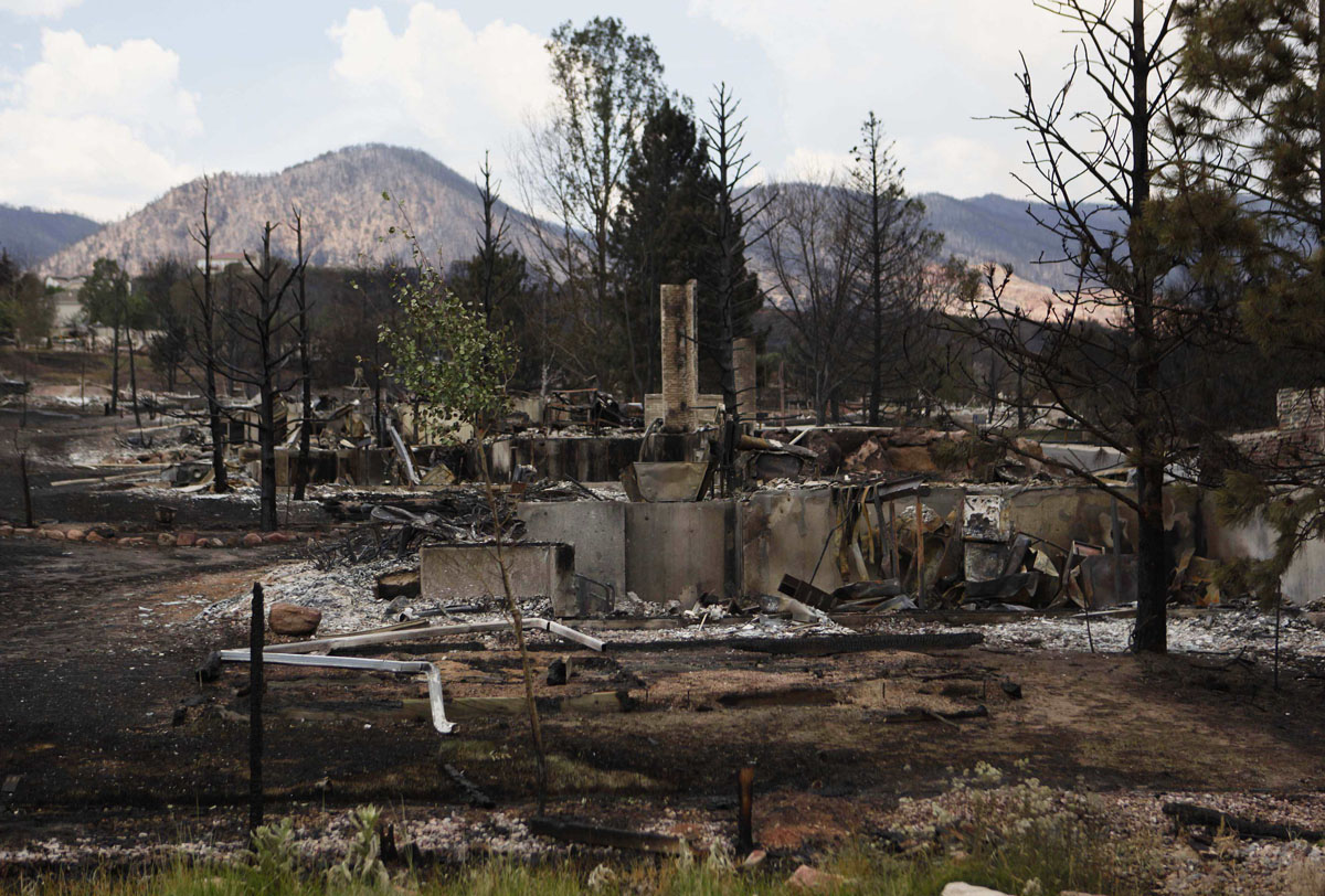 JUNE 29: A home damaged by fire stands in the Mountain Shadow neighborhood in Colorado Springs June 29, 2012. U.S. President Barack Obama declared those areas earlier today as a federal disaster area releasing federal funds to help fight the blazes (Larry Downing/Reuters)