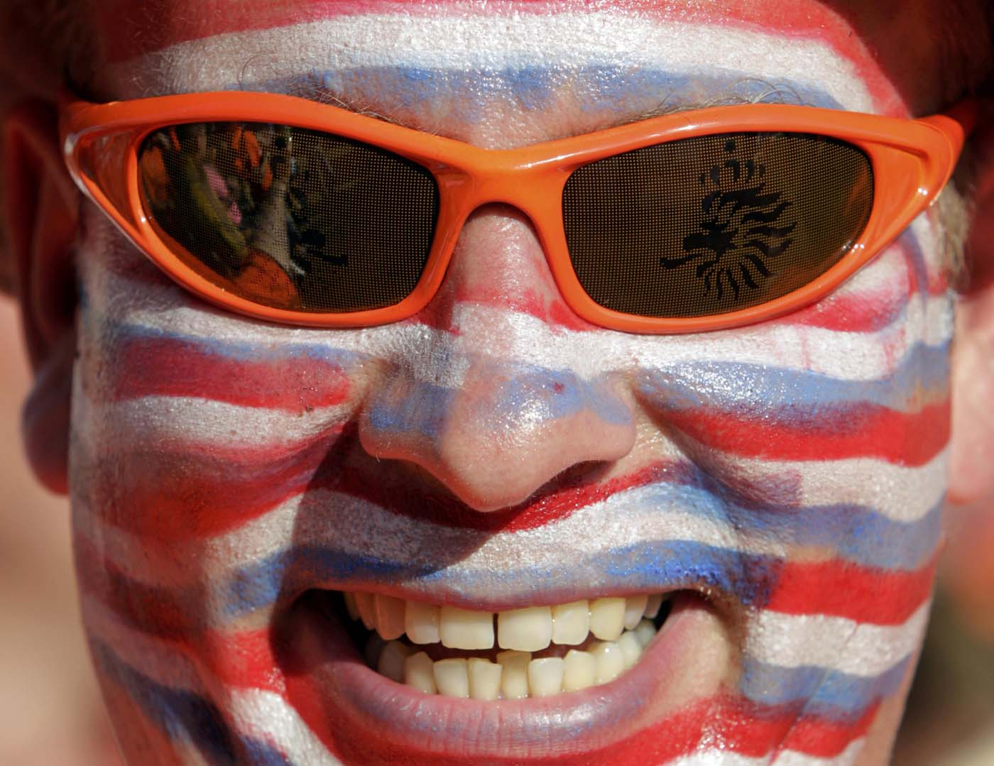 A Dutch soccer fan smiles as he relaxes at the Euro 2012 fan zone in Kharkiv, some 480 km (300 miles) east of Kiev, June 13, 2012, ahead of the Group B Euro 2012 between Netherlands and Gemany. (Vasily Fedosenko/Reuters)