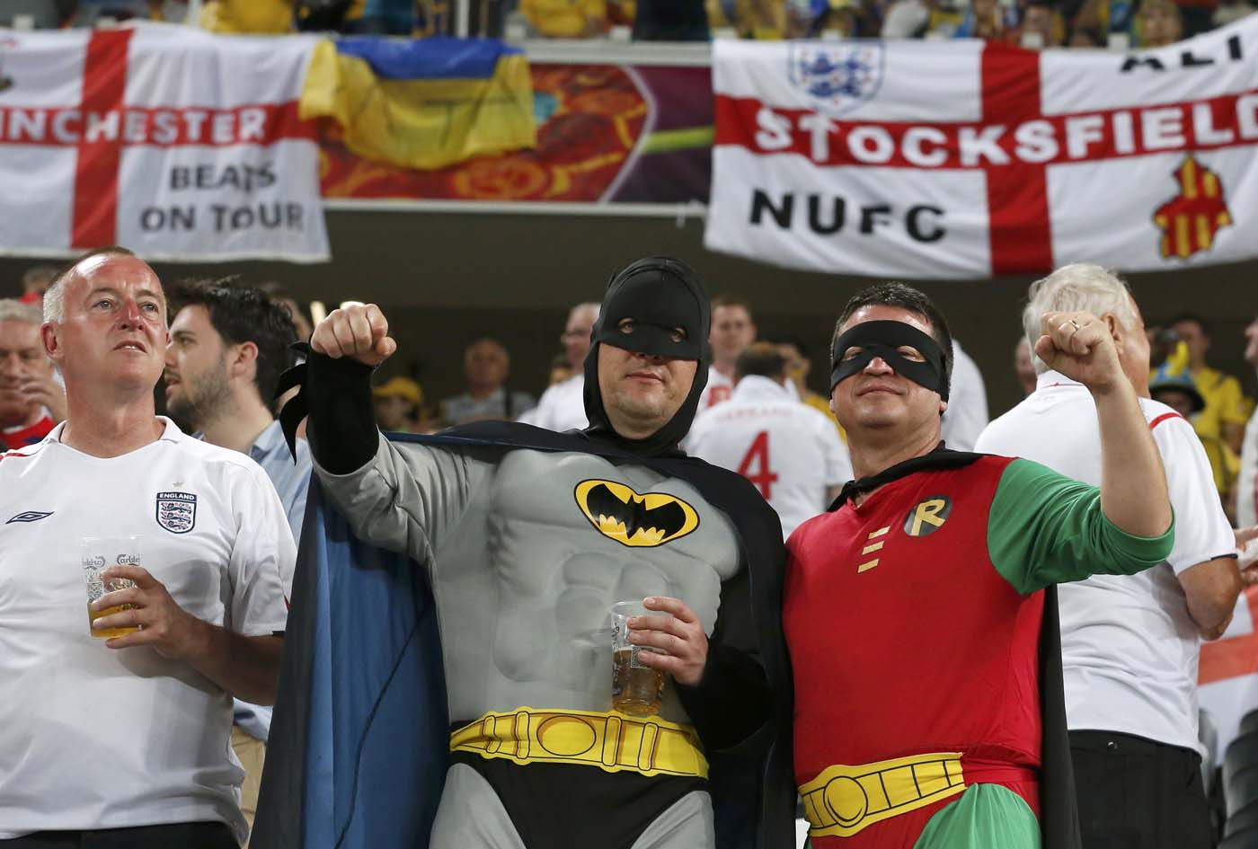 England soccer fans dressed as Batman and Robin cheer before their Group D Euro 2012 soccer match against Ukraine at the Donbass Arena in Donetsk, June 19, 2012. (Alessandro Bianchi/Reuters)