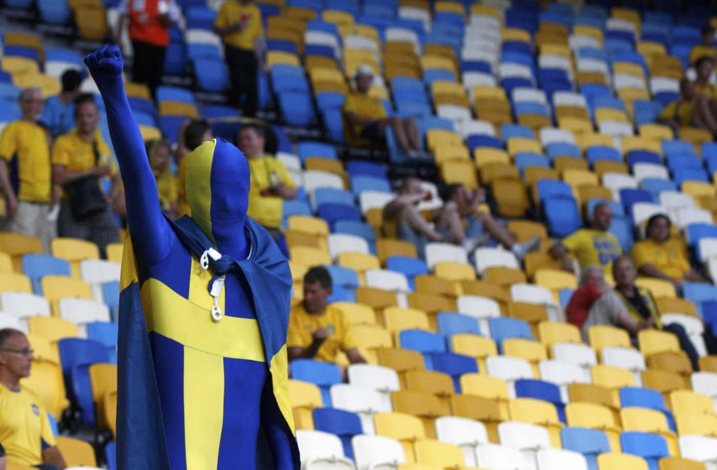 A Sweden's fan wears the outfit in the national flag shape and colors as he cheers before the Group D Euro 2012 soccer match against France at the Olympic stadium in Kiev, June 19, 2012. (Alexander Demianchuk/Reuters)