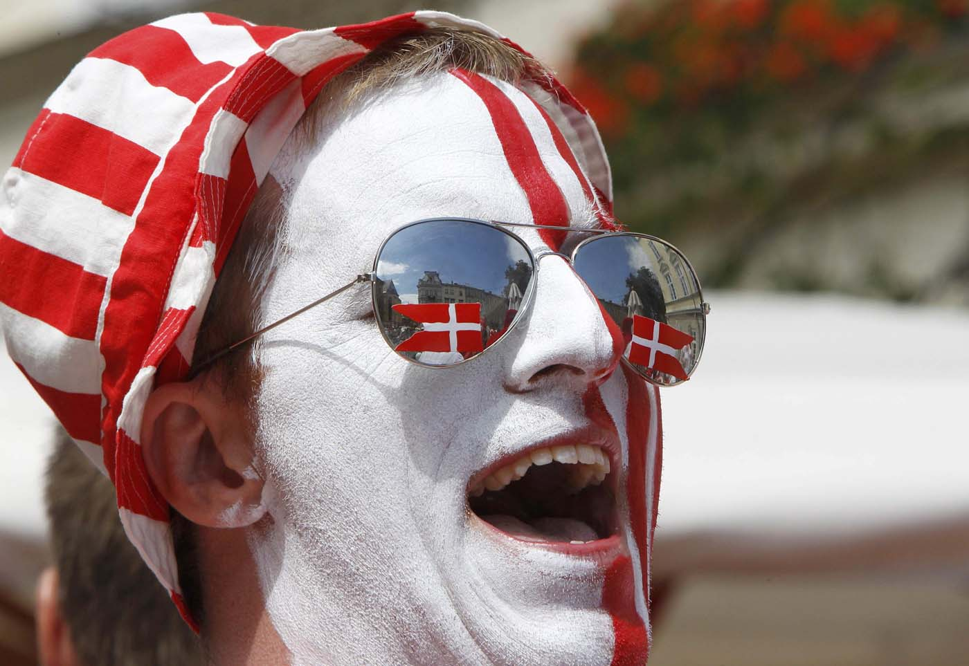 A Denmark soccer fan with his face painted in national colors smiles in Lviv June 13, 2012. (Gleb Garanich/Reuters)