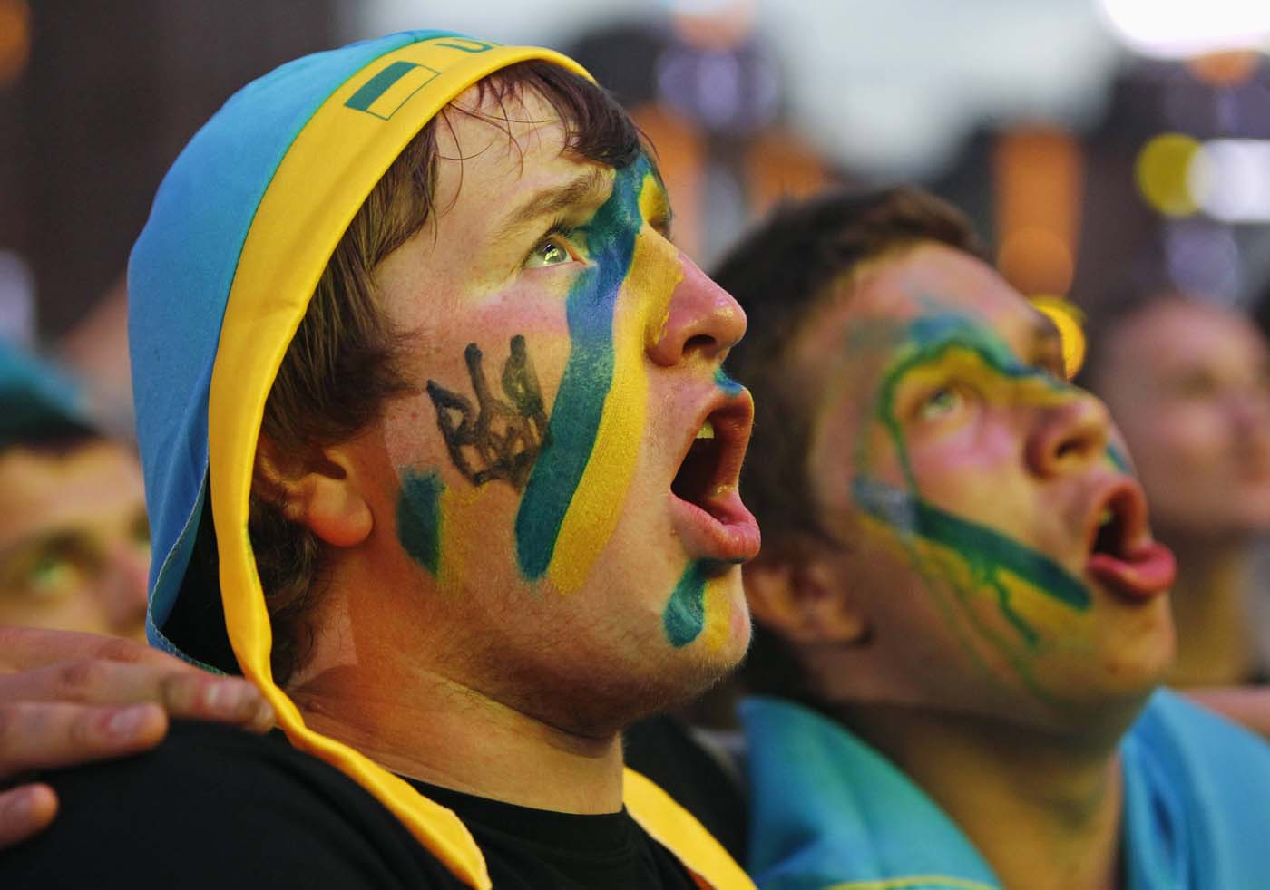 Fans of Ukraine react during a public screening of the Euro 2012 Group B soccer match between Ukraine and England in the fan zone in Kiev June 19, 2012. (Gleb Garanich/Reuters)